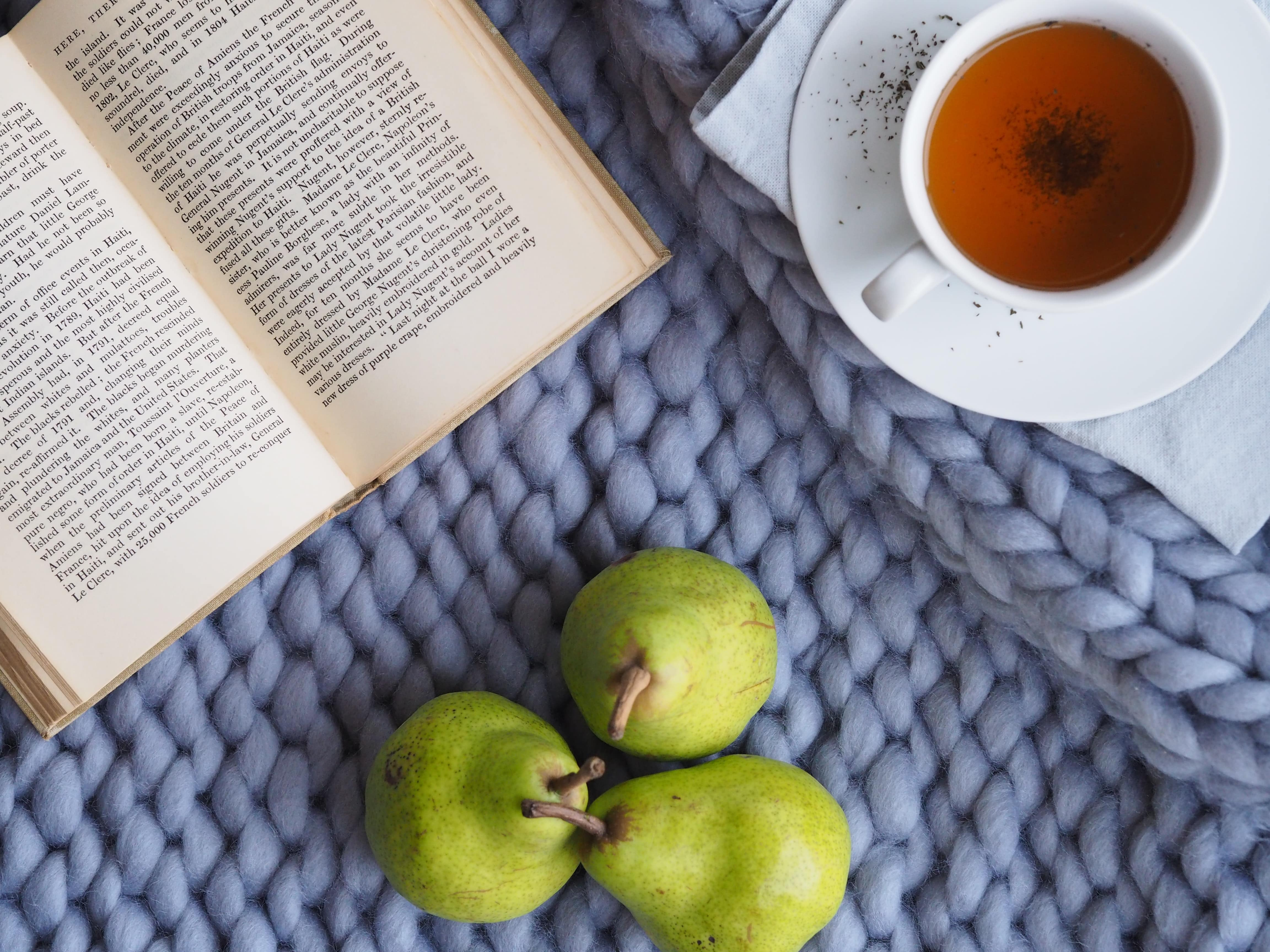 book with tea fruit and chunky comfort blanket nourish