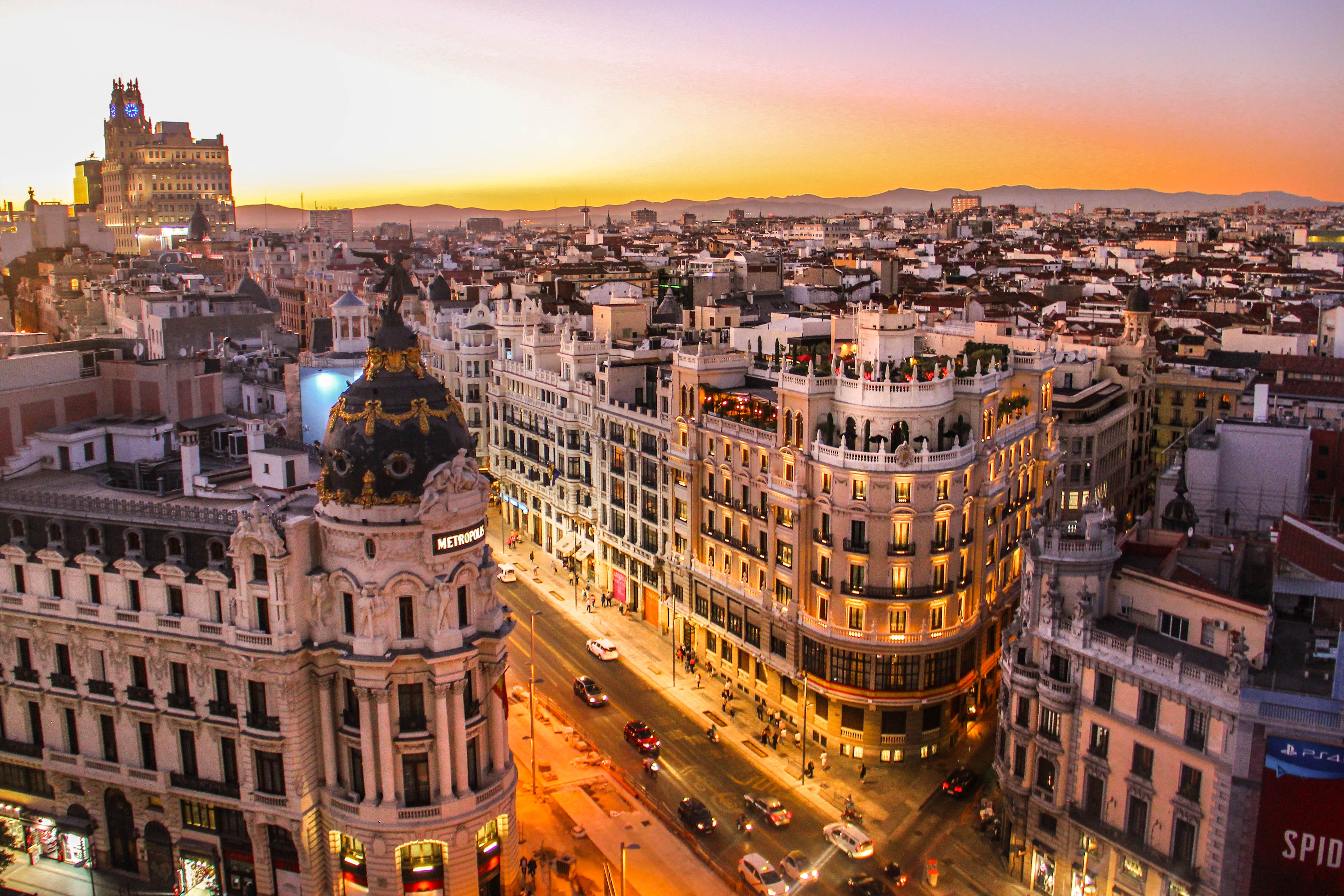 Madrid streets and skyline at sunset