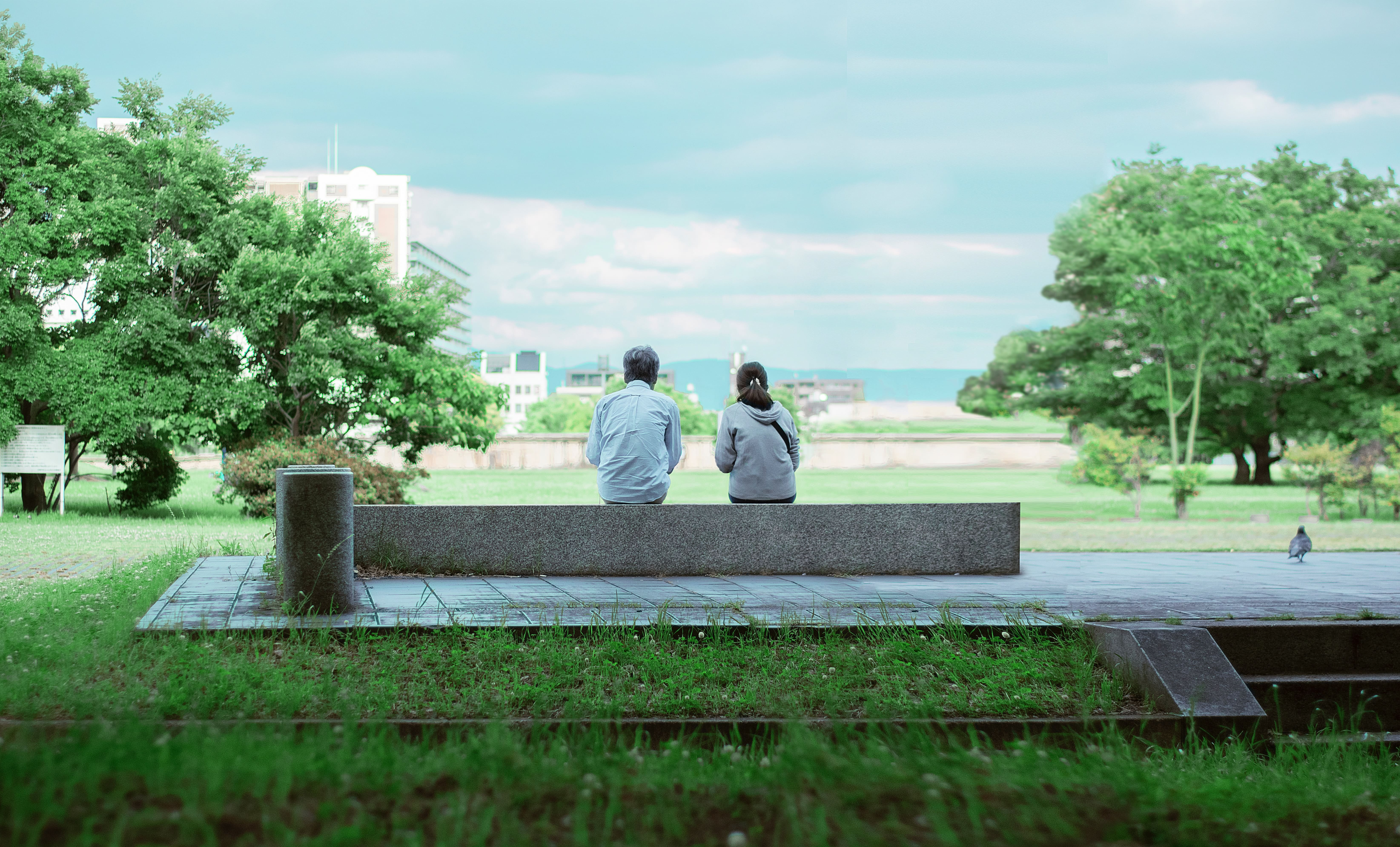 Couple outside in a park on a bench